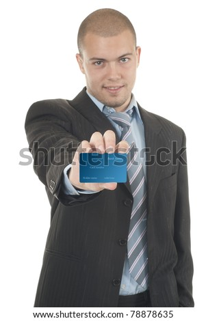 Businessman in suit holding credit card - stock photo