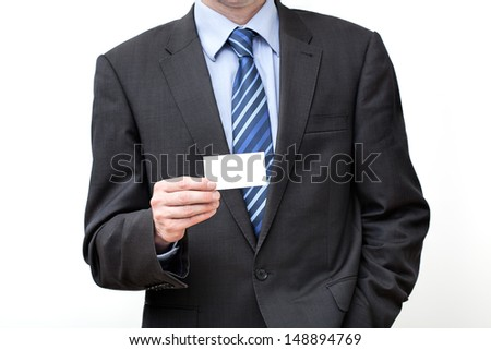 Businessman in suit holding empty business card