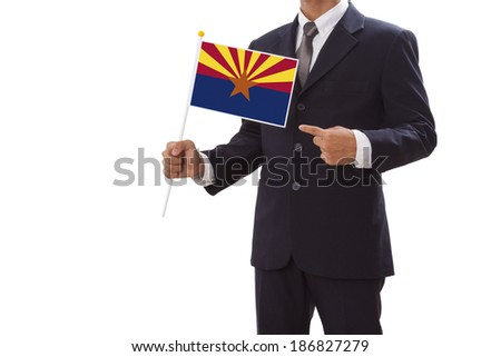 Businessman in suit holding of the Arizona State Flag  - stock photo
