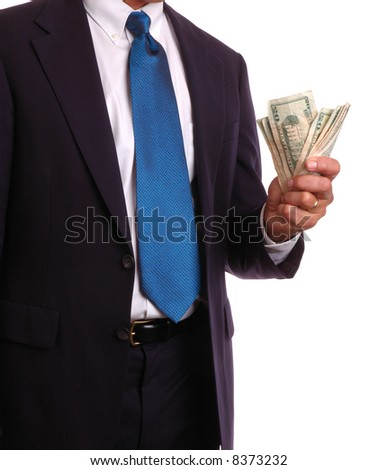 Businessman in Suit Holding US Currency isolated over white