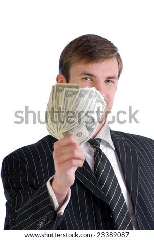 businessman in  suit holds in  hand much one-dollar denominations isolated on  white background