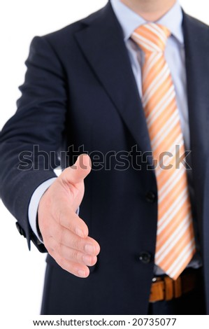 Businessman in suit is giving a handshake to you. - stock photo