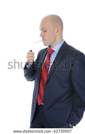 Businessman in suit lights a cigarette. Isolated on white background