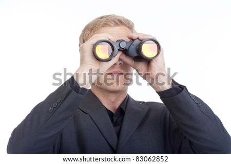 businessman in suit looking through binoculars - isolated on white