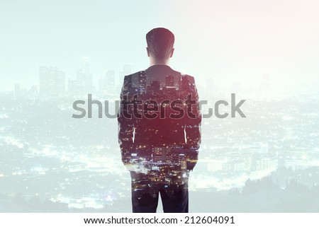 businessman in suit on a city background - stock photo