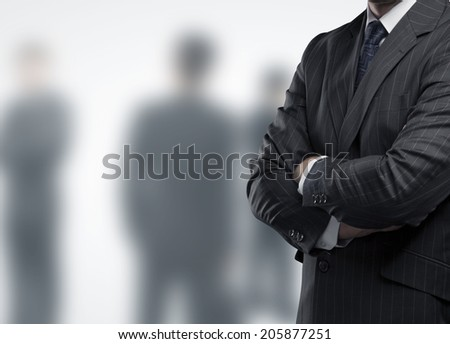 businessman in suit on a people backgound - stock photo