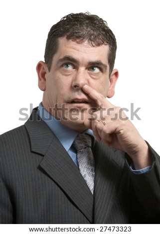 Businessman in suit picking his nose on white - stock photo