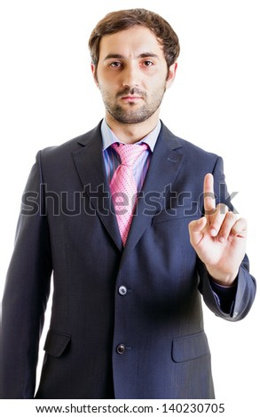 Businessman in suit points his finger isolated on white - stock photo