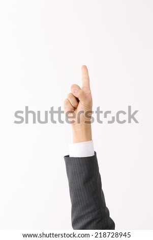 Businessman in suit shows one finger