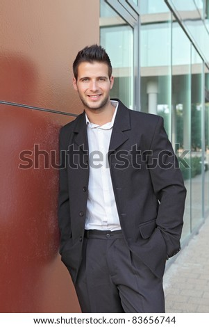 Businessman in suit standing outside