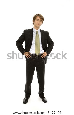 Businessman in suit stands with confidence - stock photo