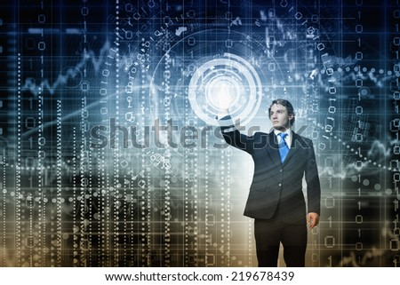 Businessman in suit touching icon of media screen - stock photo