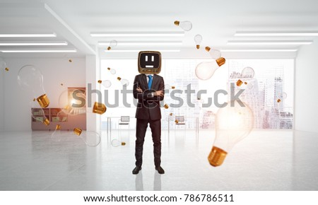Businessman in suit with an old TV instead of head keeping arms crossed while standing among flying and glowing lightbulb inside office building. 3D rendering.