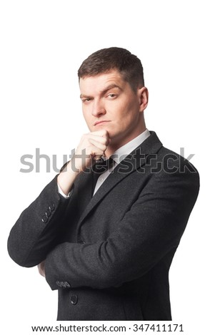 Businessman in suit with hand on chin on white isolated background