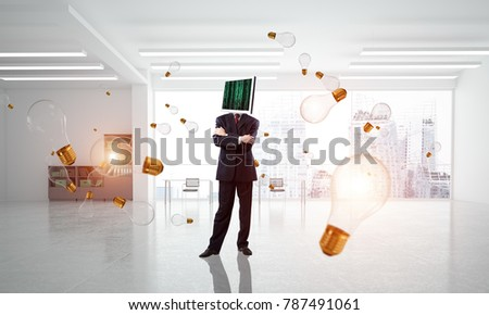Businessman in suit with monitor instead of head keeping arms crossed while standing among flying and glowing lightbulbs inside office building. 3D rendering.