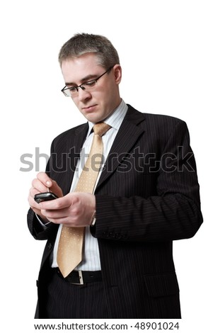 businessman in suit with smartphone - stock photo