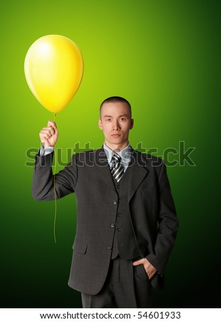 businessman in suit with the balloon - stock photo