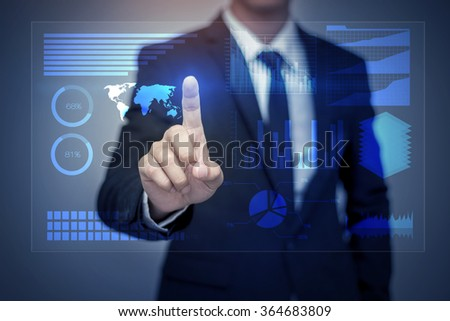 Businessman in suit working with digital virtual screen
