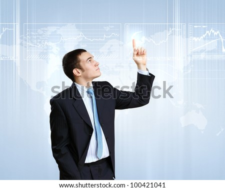 Businessman in suit working with touch screen technology - stock photo