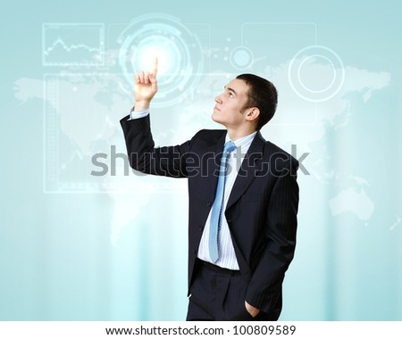 Businessman in suit working with touch screen technology