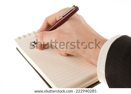 Businessman in suit writing on an empty journal binder (notepad or notebook) isolated on white - stock photo
