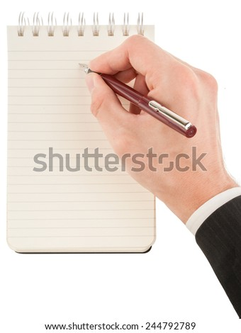 Businessman in suit writing on empty notepad (notebook) isolated on white - stock photo
