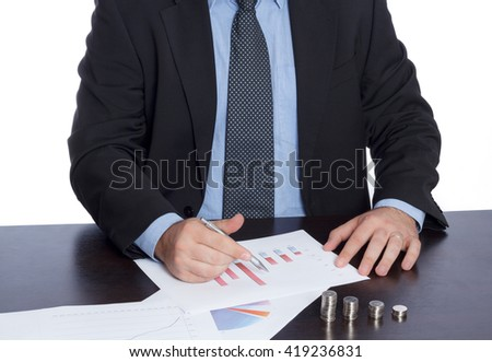 Businessman in suite and tie analyzing graphs at the office on white background, economical growing