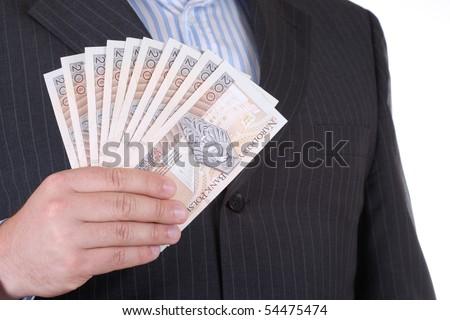 Businessman in suite holding polish money - stock photo