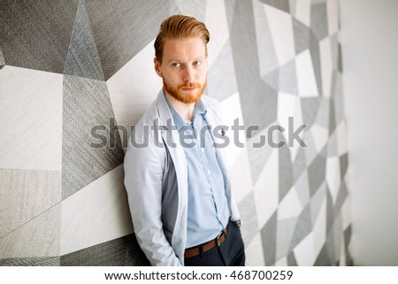 Businessman in suite portrait on stairs in office building
