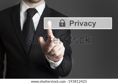 businessman in suite pressing touchscreen privacy - stock photo