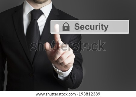 businessman in suite pressing touchscreen security - stock photo