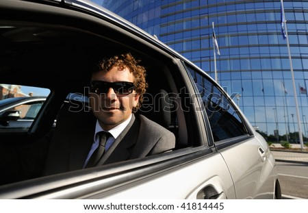 Businessman in the car - stock photo