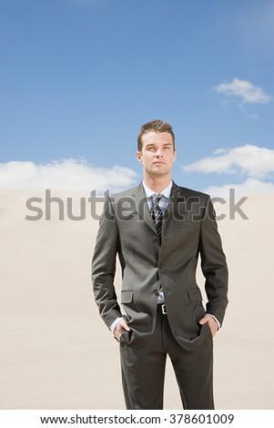 Businessman in the desert - stock photo