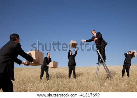businessman in the field delivering a package