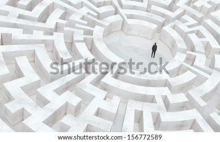 businessman in the middle of a maze - stock photo