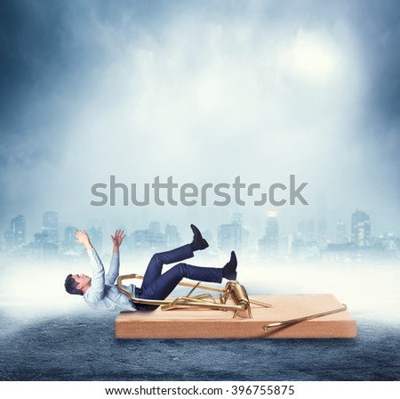 Businessman in the mouse-trap - stock photo