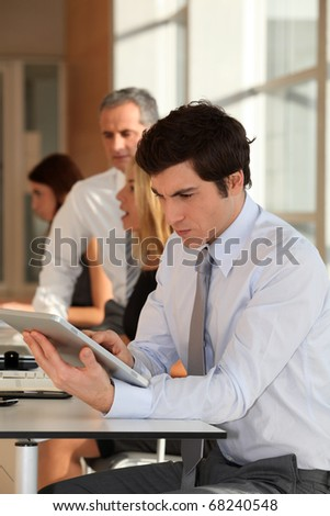 Businessman in the office with electronic tab
