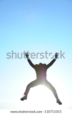 Businessman in the sunlight - stock photo