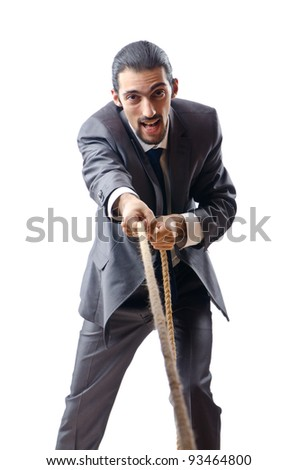 Businessman in the tug of war concept - stock photo