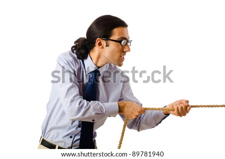 Businessman in tug of war concept - stock photo