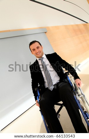 Businessman in wheelchair going to attend congress meeting - stock photo