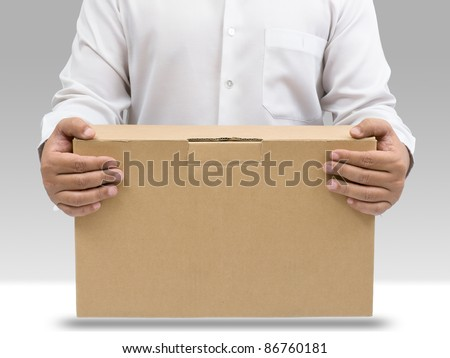 Businessman in white shirt carry brown paper box - stock photo