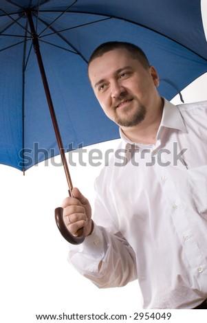 businessman in white shirt standing under blue umbrella - stock photo