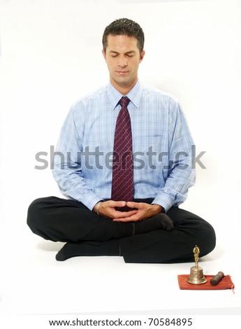 Businessman in yoga style on white background. - stock photo