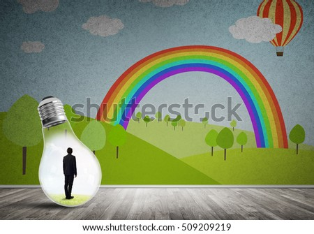 Businessman inside light bulb in room against nature drawn concept