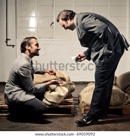 businessman inspects the coffee beans for quality - stock photo
