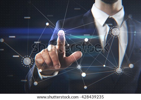 Businessman interacting with futuristic interface