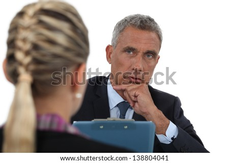 Businessman interviewing a young woman - stock photo