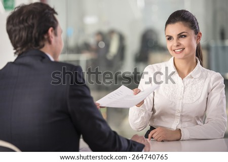 Businessman interviewing female candidate for job in office. - stock photo