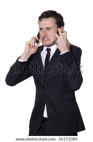 businessman is angry yelling and screaming at the phone - stock photo